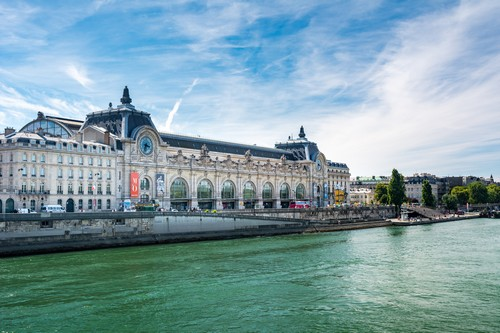 Paris, France - August 14, 2016: Orsay Museum, seen from the right bank of the Seine river. Notice that the museum building was originally a railway station. (Paris, France - August 14, 2016: Orsay Museum, seen from the right bank of the Seine river.